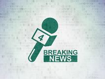 News concept: Breaking News And Microphone on Digital Data Paper background Royalty Free Stock Photo