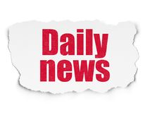 News concept: Daily News on Torn Paper background Royalty Free Stock Images