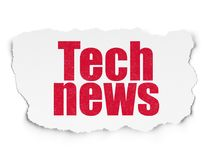 News concept: Tech News on Torn Paper background. News concept: Painted red text Tech News on Torn Paper background with  Tag Cloud Royalty Free Stock Images