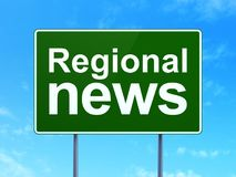 News concept: Regional News on road sign background. News concept: Regional News on green road highway sign, clear blue sky background, 3D rendering Royalty Free Stock Photography