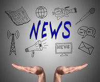 News concept sustained by open hands Royalty Free Stock Images