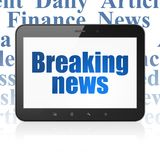 News concept: Tablet Computer with Breaking News on display. News concept: Tablet Computer with  blue text Breaking News on display,  Tag Cloud background, 3D Royalty Free Stock Image