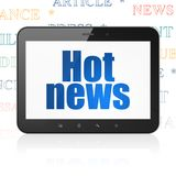 News concept: Tablet Computer with Hot News on display. News concept: Tablet Computer with  blue text Hot News on display,  Tag Cloud background, 3D rendering Royalty Free Stock Photo