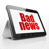 News concept: Tablet Computer with Bad News on display. News concept: Tablet Computer with red text Bad News on display, 3D rendering Stock Image