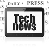 News concept: Tablet Computer with Tech News on display. News concept: Tablet Computer with  black text Tech News on display,  Tag Cloud background, 3D rendering Royalty Free Stock Photography