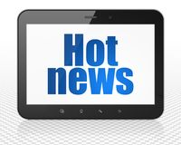 News concept: Tablet Pc Computer with Hot News on display. News concept: Tablet Pc Computer with blue text Hot News on display, 3D rendering Royalty Free Stock Photo