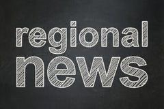 News concept: Regional News on chalkboard background Stock Photos