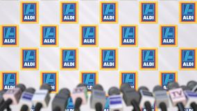 News conference of ALDI, press wall with logo as a background and mics, editorial 3D rendering stock image