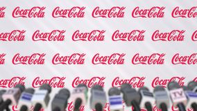 News conference of Coca-Cola company, press wall with logo as a background and mics, editorial animation stock video footage