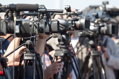 News conference. Filming an event with a video camera. Stock Images