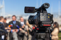 News conference. Filming an event with a video camera. Royalty Free Stock Images