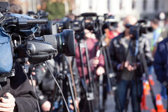 News conference. Filming an event with a video camera. Royalty Free Stock Photos