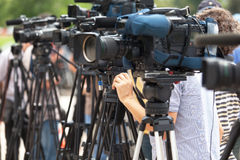 News conference. Filming an event with a video camera. Stock Photos