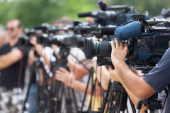 News conference. Filming an event with a video camera. Stock Photography