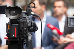 News conference. Journalism. Filming press conference with a video camera. Spokesman Royalty Free Stock Photos