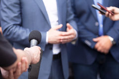 News conference. Media interview. Journalists making interview with businessperson, politician or spokesperson. Press conference Stock Photos