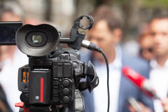News conference. Media interview. Press conference. Broadcast journalism. Spokesman Stock Photo
