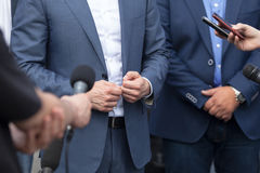 News conference. Media interview. Spokesperson. Journalists making interview with businessperson, politician or spokesman. Press conference Stock Photos