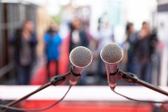 Press conference. Public relations - PR. News conference. Microphones in focus against blurred background Royalty Free Stock Photo