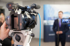 News conference. Spokesman. Filming an event with a video camera. Spokesperson Royalty Free Stock Photo