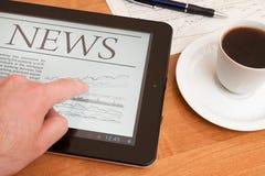 News on digital tablet. Royalty Free Stock Photo