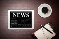 News on digital tablet. Stock Photography