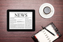 News on digital tablet. Royalty Free Stock Images