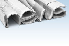 News and events of company. Stacks of modern newspapers, composed in form of word NEWS on gradient background. Concept of news and events of company Royalty Free Stock Images