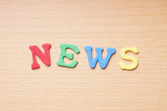 News in foam rubber letters Stock Photography