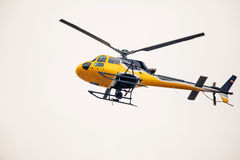 News helicopter in flight Stock Images