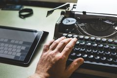 Man Hand On Old Typewriter And Digital Tablet. Journalism Report Stock Images