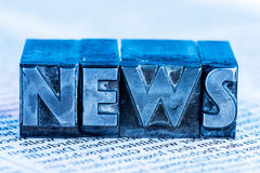 News in lead letters Stock Photo