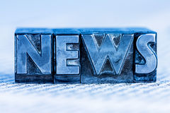 News in lead letters. The word news written with lead letters. photo icon for newsletters, newspapers and information Stock Image