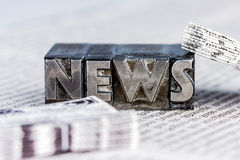 News in lead letters. The word news written with lead letters. photo icon for newsletters, newspapers and information Royalty Free Stock Photo