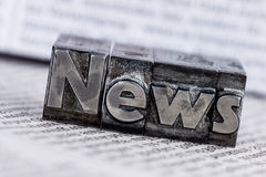 News in lead letters. The word news written with lead letters. photo icon for newsletters, newspapers and information Royalty Free Stock Images
