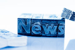 News in lead letters Stock Photos