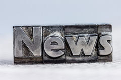 News in lead letters. The word news written with lead letters. symbolic photo for newsletters, newspapers and information Stock Photography