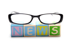 News. Letters  with glasses on isolated background Royalty Free Stock Image