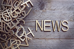 News. And media concept wood letters on wooden background Stock Photo