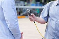 News. Media interview. Microphone in focus. Press or media interview Stock Photography