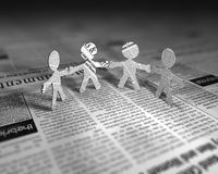 News Men. A few cut out figures made of newspapers Royalty Free Stock Photography