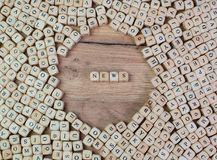 News name in letters on cube dices on table royalty free stock image