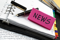 News note on agenda and pen Stock Photo