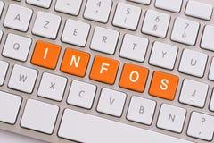 News in orange on white keyboard Royalty Free Stock Images