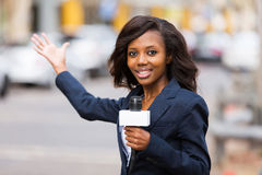News reporter broadcasting Stock Images