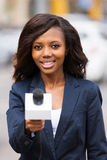 News reporter interviewing. Beautiful african news reporter interviewing with microphone Stock Photography