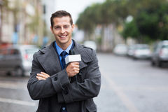 News reporter outdoors. Confident young news reporter working outdoors in the rain Royalty Free Stock Photo