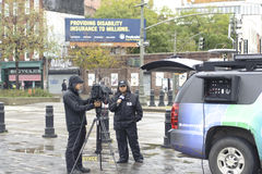 News reporter by the pier. News reporter in lower manhattan after super storm Sandy Stock Images