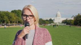 Reporter talking in front of US Capitol building