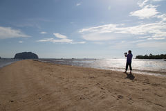 News Reporter video Golden Scale Dragon Spine Beach in Palian of. Trang, Thailand - December 10, 2015: News Reporter video Golden Scale Dragon Spine Beach in Stock Photo